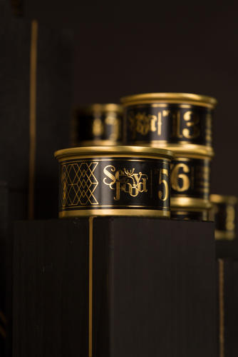 <p>Each snack is packaged in a luxurious-looking black and gold can. Instead of a picture of what's inside, the package is numbered, an homage to Chanel perfume.</p>