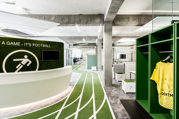 <p><strong>Ready For The Rat Race</strong></p>  <p>A love of sport is infused into the Berlin offices of <a href=&quot;http://www.onefootball.com/&quot; target=&quot;_blank&quot;>Onefootball</a>, an app for worldwide soccer news and updates. Created by  Munich-based architecture firm <a href=&quot;http://tkezarchitecture.com/&quot; target=&quot;_blank&quot;>TKEZ</a>, the app's <a href=&quot;http://www.fastcodesign.com/3038625/this-office-has-a-running-track&quot; target=&quot;_self&quot;>home base features a running track</a> that snakes through the 15,000-square-foot space, bookended by goal posts on either end. Adding to the sporty aesthetic are locker-room-style cabinets, stadium seating, game tactics decorating the floors, and of course, foosball tables.</p>