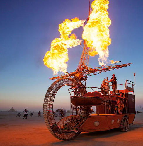 <p>Artist: Andy Tibbetts<br /> A handcrafted pirate ship vehicle, driven by an ingenious front wheel with no axle.</p>