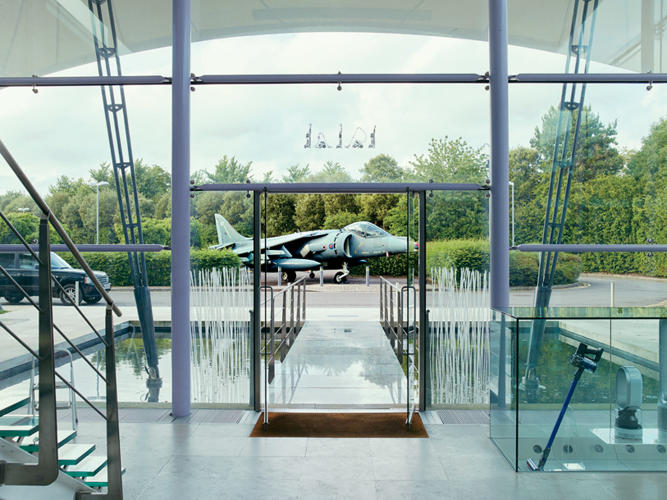 <p>The front entrance to Dyson's headquarters features a decommissioned Harrier jet, known for its lightness and maneuverability.</p>