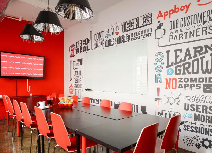 <p>This conference room is covered in inside jokes and brand content, helping to add identity and personality to the space.</p>