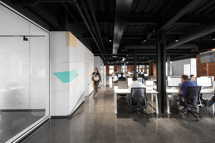 <p>Keeping the color palette restrained helps the architecture pop. For visual consistency, everything over nine feet above the floor was painted black to create a datum line that unifies the spaces.</p>