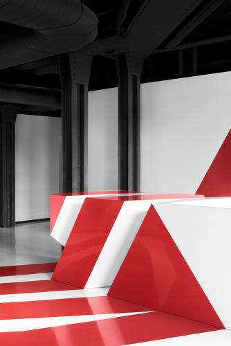 <p>In the reception area, a bit of anamorphic design enlivens the Spartan space. As people move around the supergraphic painted on the desk, Lightspeed's logo comes in and out of view. &quot;As the other, more industrial aspects of the space start to register—the rough-hewn bricks walls and exposed mechanical system—the crispness of the form stands out even more,&quot; architect Maxime-Alexis Frappier says. Léandre Baillargeon fabricated the design.</p>