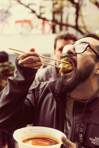 <p>An enthusiastic foodie enjoys the Lower East Side dumpling tour.</p>