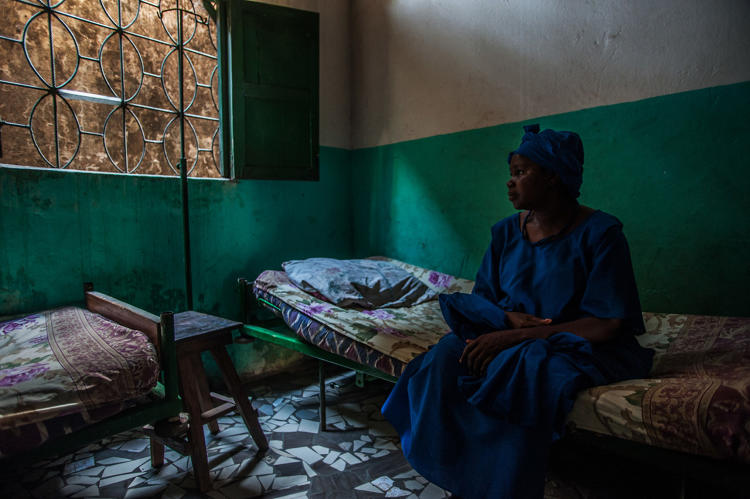 <p>&quot;Nana Camara, 48, waits to see the nurse at La Clinic Cabinet Medical in the Nongo neighbourhood of Guinea's capital, Conakry. Camara has been suffering from malaria for four days, but had been unable to come to the clinic sooner due to lack of funds.&quot;</p>