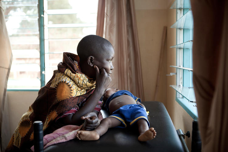 <p>&quot;Mama Fidès sits beside her son, who is 11 months old and suffering from high fever and anemia caused by severe malaria. The child needs a blood transfusion that is not available at Kirundo Hospital. Mama Fidès waits and hopes it will come soon enough.&quot;</p>