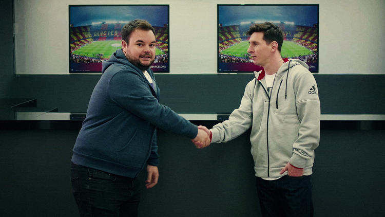 <p>Comedian Lloyd Griffith shakes hands with soccer legend Lionel Messi as part of his EA Sports-sponsored worldwide quest to put together the greatest team possible.</p>