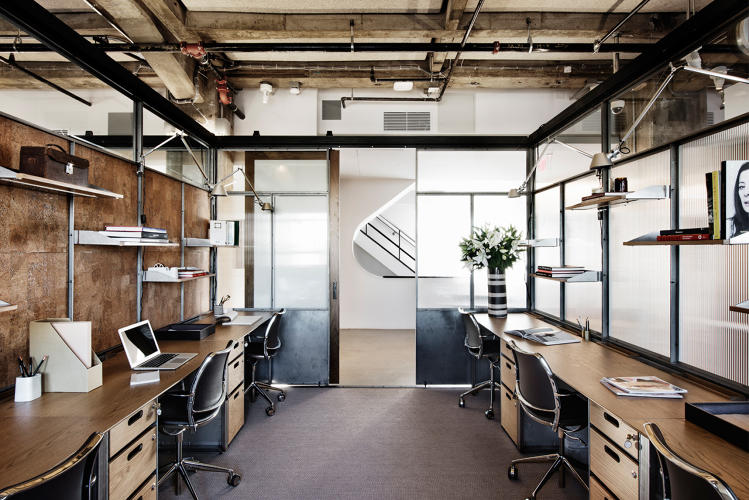 <p>The upper floors offer more private studios for working.  Design details include custom desks and the STUA Gas swivel design chair.</p>