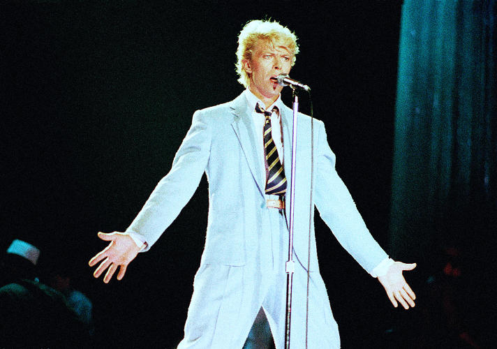 <p>In 1980, Bowie abandoned the rapid-fire costume changes that he'd become known for in the 1970s, but his resulting look -- a cool blue suit -- is no less iconic.</p>