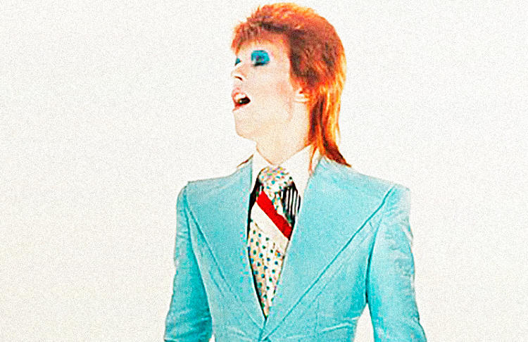 <p>Designed by Freddie Buretti,  this turquoise &quot;ice-blue&quot; suit was featured in the music video for 'Life From Mars' from the album <em>Heroes</em> in May 1973.</p>