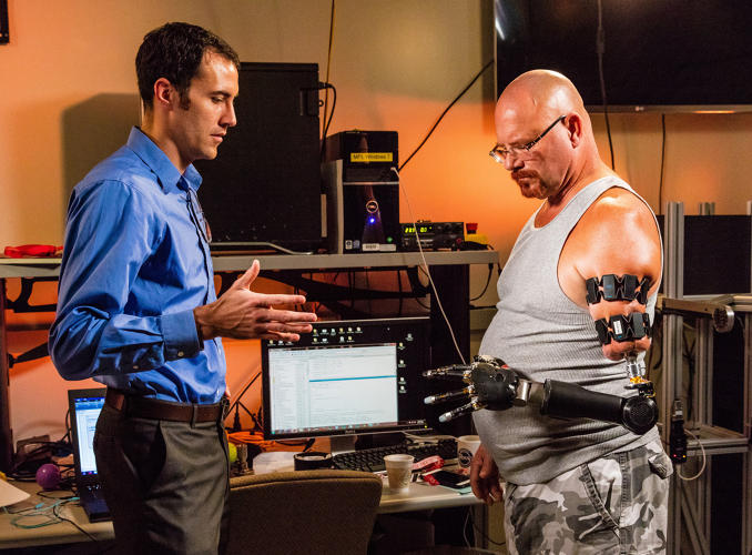 <p>Matheny controls the arm via a Myo, a gesture-control armband that anyone can buy (it's sold on Amazon).</p>
