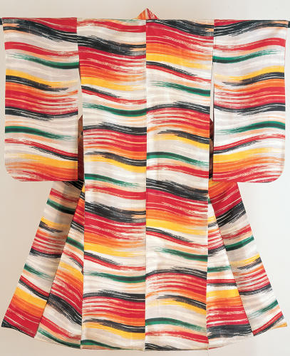 <p>Kimono for a woman. Wavy horizontal stripes.<br /> Machine-spun plain weave pongee silk (meisen); stencil-printing of warp and weft threads (heiyō-gasuri) Shōwa period, 1930–40, 144 x 122, K46.<br /> This completely abstract design conveys a sensation of pure movement and brilliant energy. The colorful lines appear to have been painted directly onto the fabric in a burst of spontaneous creativity, but in fact have been carefully composed and dyed onto the warp and weft threads, before the cloth was woven on the loom. This dazzling kimono is a tour de force of textile design, and the woman who wore it must have created quite an impact while walking through the streets of pre-war Japan.</p>