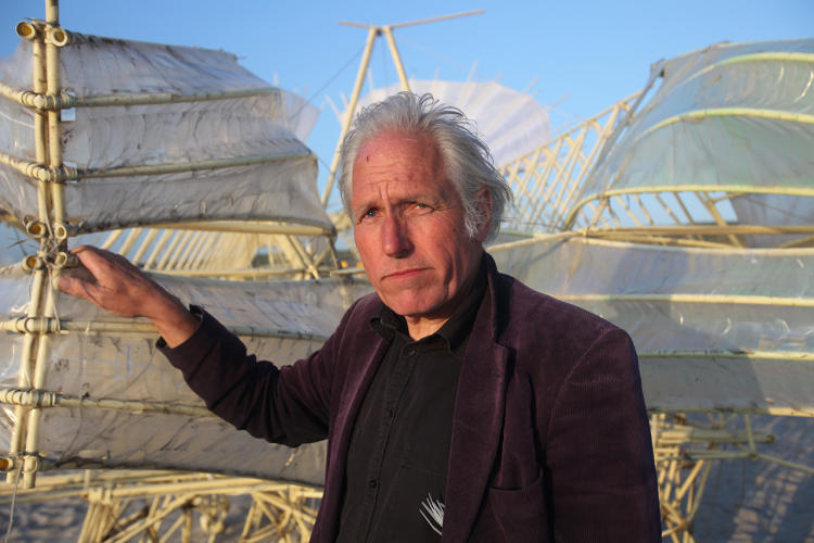 <p>Theo Jansen with one of his Strandbeest's--kinetic sculptures made of PVC pipe, zip ties, water bottles and cloth sails.</p>