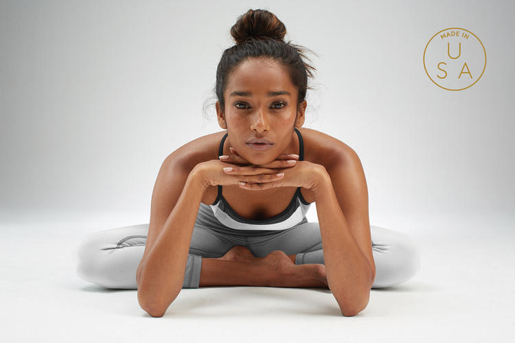 <p>Yogasmoga, a yogawear maker known for performance fabrics, is one of a growing number of retailers who have decided to make their clothes in the U.S.</p>