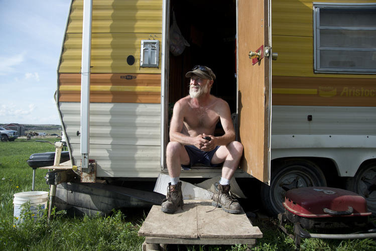 <p>Scott Collins again, outside of his mobile home.</p>