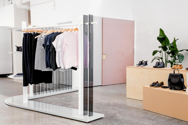 <p>With the limited amount of space, the designers created a collapsible fitting room that appears as two large panels of fabric when closed.</p>