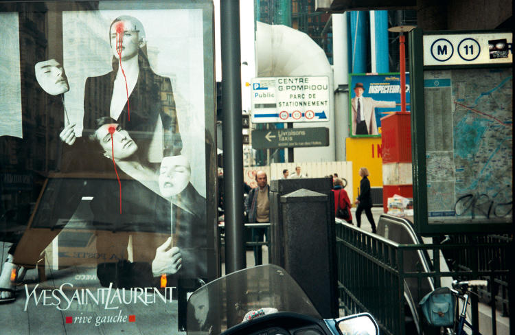 <p>Zevs, <em>Visual Attack - Yves Saint Laurent</em>, 2001. Paint on Yves Saint Laurent (sidewalk) poster, Paris</p>