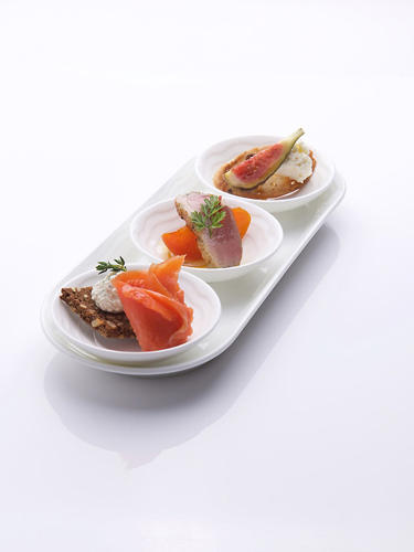 <p>Walnut baguette with feta cheese, fresh fig, and truffle-infused honey, and wild smoked salmon, lemon, and cumin cream cheese on Norlander bread—Emirates</p>