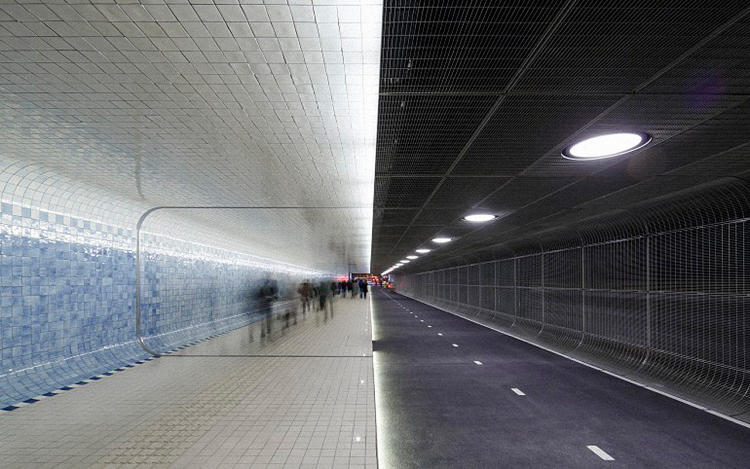 <p>A new tunnel in Amsterdam connects people to the main railway station and to the port, where they can continue by ferry.</p>