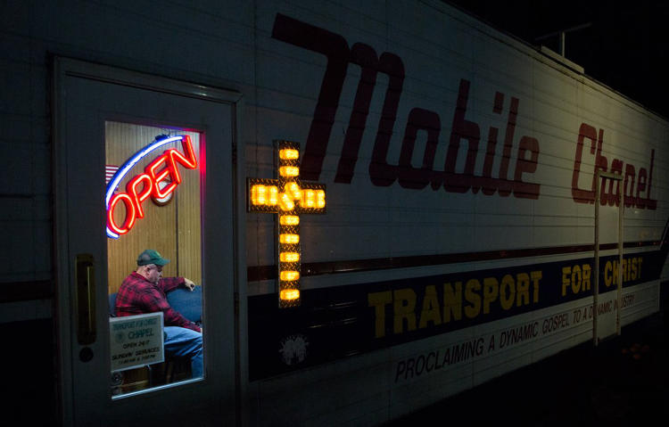<p>Truck driver Ben Blackburn, 46, participates in a Bible study session at the Transport For Christ (TFC) mobile chapel in Lodi, Ohio, on Oct 23 2013.</p>