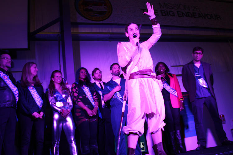 <p>co-founder of Yuri's Night (and dressed as <em>Star Wars' </em>Rey) introduces the evenings space industry ambassadors.</p>
