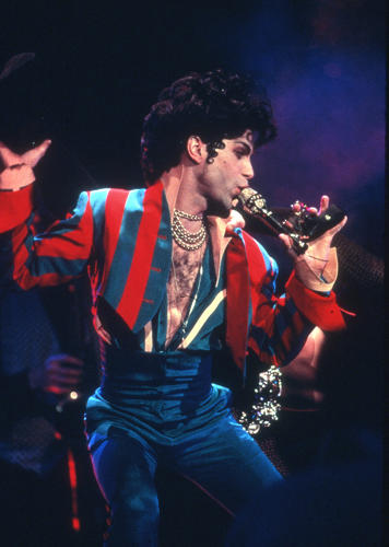 <p>The outfit at Radio City Music Hall in 1993 shows off both his love for stripes and high-waisted pants. And of course, that glorious silk deep-V.</p>