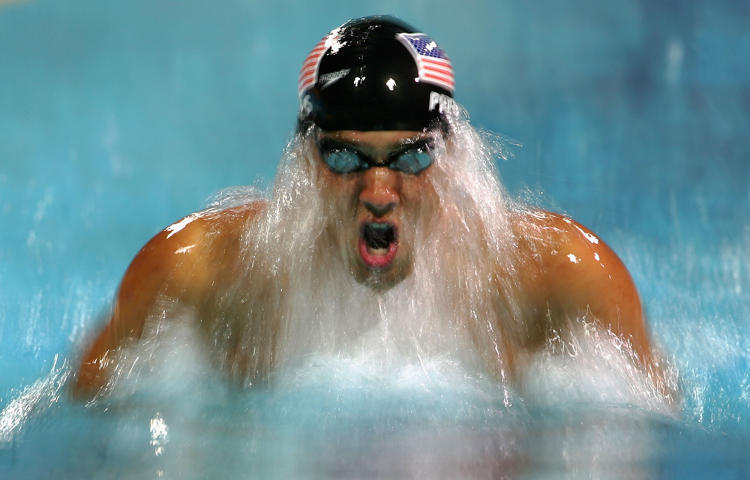 <p>Athens 2004: Michael Phelps competes in the men's swimming 200 metre individual medley final.</p>