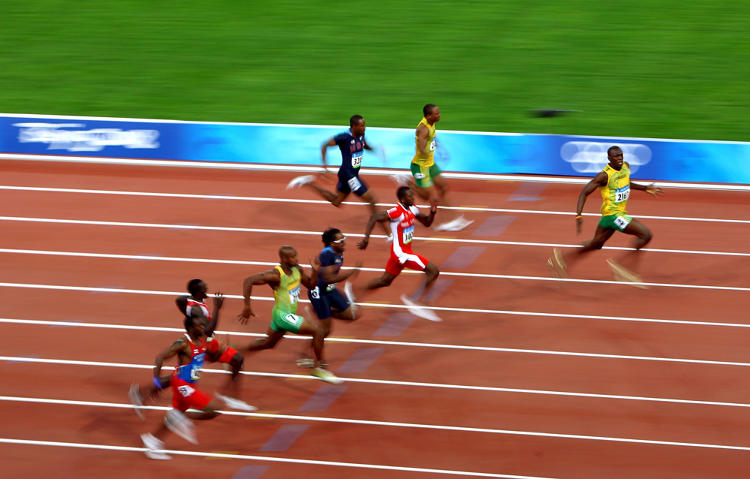 <p>Beijing 2008: Usain Bolt celebrates winning the Men's 100m Final, with a new world record time of 9.69 seconds.</p>