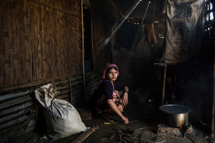 <p>Say Tha Mar Gyi, Myanmar, 2015: A. cooks in her family home in Say Tha Mar Gyi Camp. She is married, but her husband left her within the last year to return to his family. ©Lynsey Addario</p>