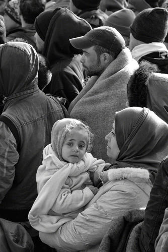 <p>Near Berkasovo, Serbia, 2015: A mother carries her daughter across the border between Serbia and Croatia. ©Tom Stoddart</p>