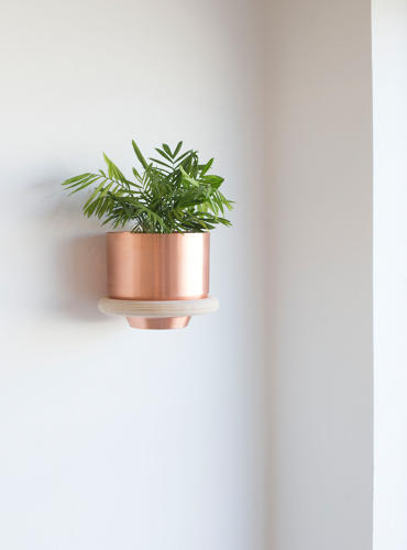<p>Spun planters and the wooden plant ring were inspired by Gant and Deming wanting to bring the lush Florida greenery indoors.</p>