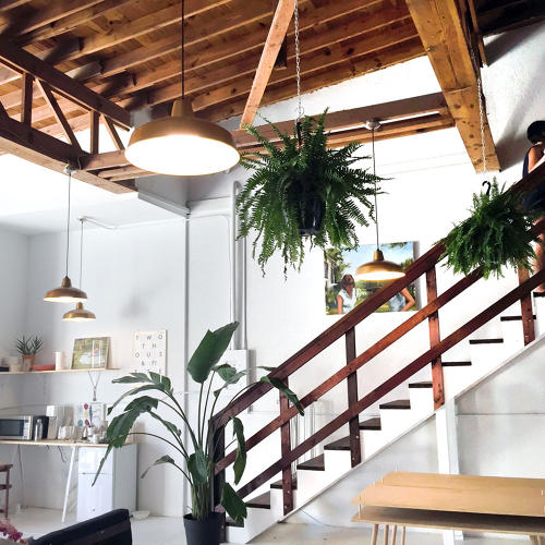 <p>Andrew Deming and Rachel Gant of the product design studio Yield moved to St. Augustine, FL three years ago. This is their airy, split level studio.</p>