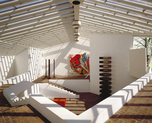 <p>Johnson built a painting gallery and sculpture gallery on site. Here, the sculpture gallery displays works by Donald Judd and Frank Stella, among others.</p>
