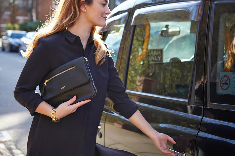 <p>The Elektronista ($350) clutch comes with a battery charger and designated pockets for a tablet, phone, and cords.</p>