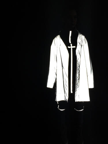 <p>Here's how a reflective coat would look at night. This treatment helps avoid car crashes for people walking on roads with no light.</p>