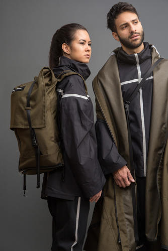 <p>The garments are utilitarian, robust pieces that transform based on what a refugee may need, like this unisex coat that folds into a backpack.</p>