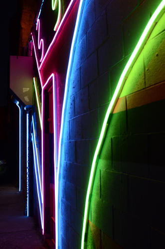 <p>It's brightly lit now, but not with streetlights: Houses are plastered in glowing street art.</p>