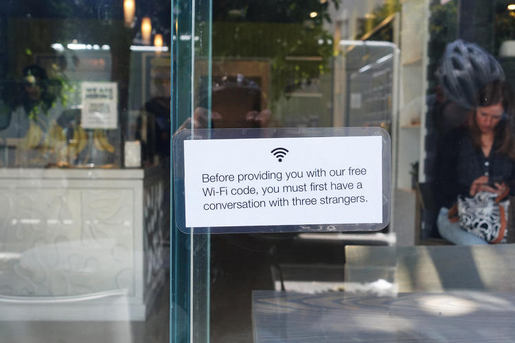 <p>&quot;Before providing you with our free Wi-Fi code, you must first have a conversation with three strangers.&quot;</p>