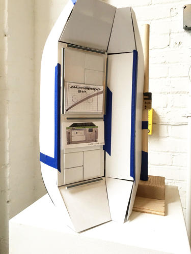 <p>A study model of a toolkit door. The six doors open up into self-contained areas for cooking, medical supplies, calling home, etc.</p>