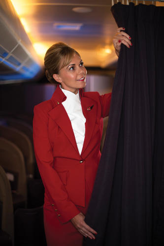 <p>Virgin Atlantic Airways female flight attendant in uniform by Vivienne Westwood c. 2014</p>