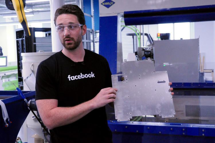 <p>Facebook CNC model maker Spencer Burns shows off a sheet metal component made in the lab.</p>