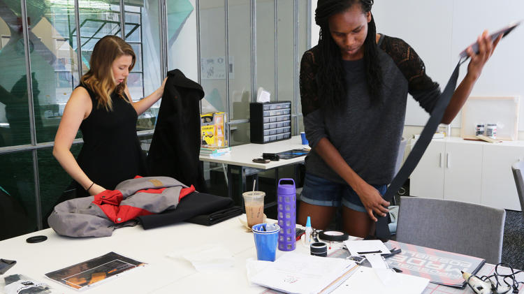 <p>Morgan Kane, a graduate student in Occupational Therapy at Tufts, and Chika Uzoma Eke, an MIT masters student in engineering, create Michael's jacket.</p>