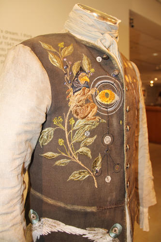 <p>Apothecarist's embroidered vest design of a creature depicting yellow fever atop an herbal cure.</p>