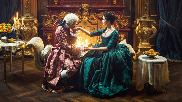 <p><strong>Lionel Lingelser</strong> as King Louis XV, <strong>Caitriona Balfe</strong> as Claire Randall Fraser</p>