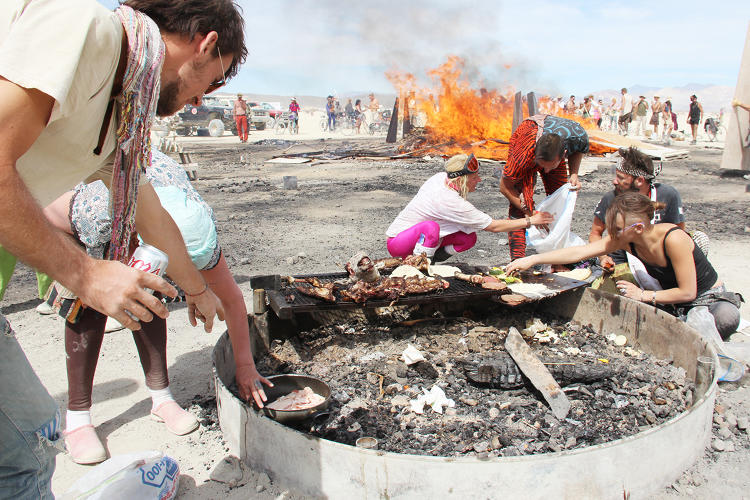 <p>Burners cook breakfast on the still-burning embers the morning after the Man burns.</p>