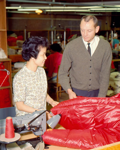<p>Famed mountaineer Pete Schoening inspects a down parka in 1966.</p>