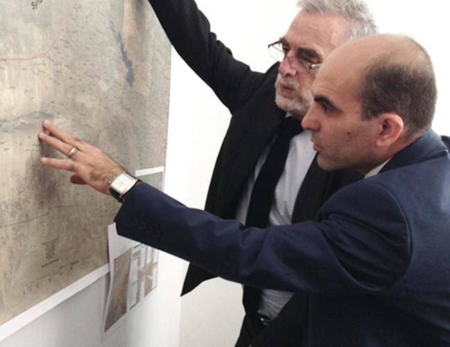 <p>In Dohuk, Iraq, last year, Luis Moreno-Ocampo meets with the head of the  genocide investigation unit, who is showing Moreno-Ocampo the areas where ISIS attacked Sinjar in August 2014.</p>
