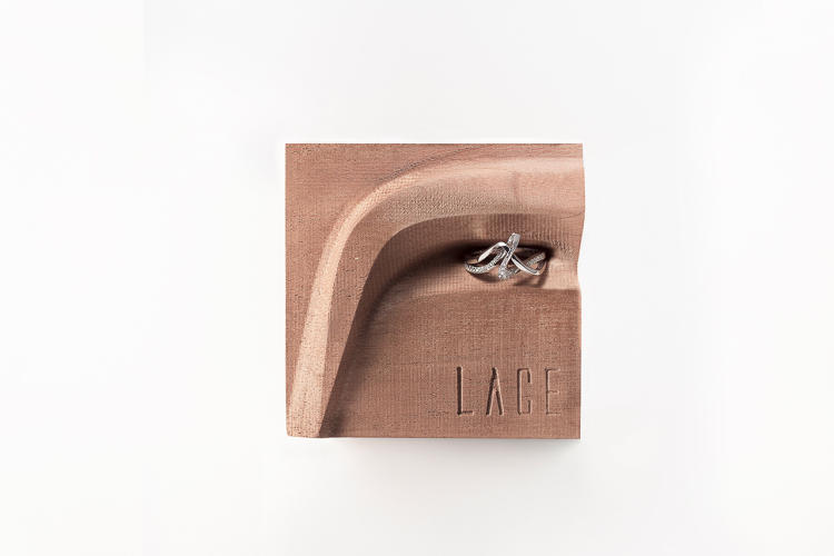 <p>Amare ring on CNC milled wood pedestal, by Jenny Wu</p>