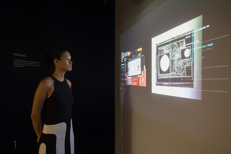 <p>A visitor to the exhibition watches a projection of the Recognition computer program searching through the Tate's collection to find matches.</p>