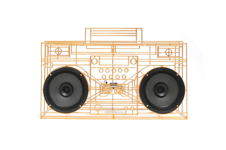 <p>Yuri Suzuki's Quest-ce que cest uses the shape of a '70s boombox, but reduces the components down to the bare minimum to achieve a wireframe look.</p>